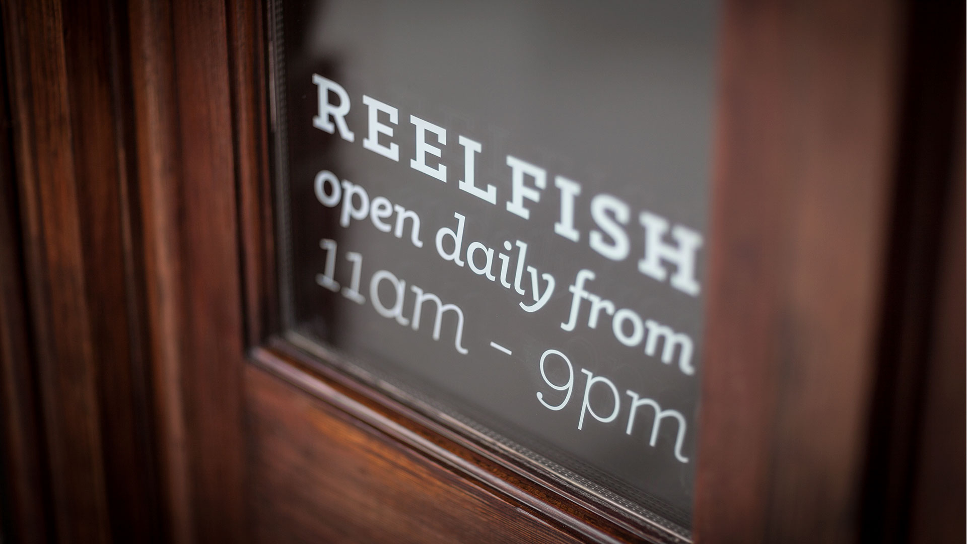 reelfish restaurant window signage